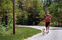 STAFF PHOTO SAMANTHA BAKER &bull; @NWASAMANTHA<br /> Canyon Sowers trains with his dog, Louie, Friday, May 2, 2014, at his home outside of Fayetteville.
