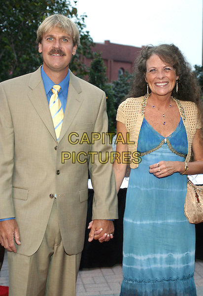 """DONNA K. PEARSON.Red carpet of """"Bell Witch-The Movie"""" premier at the Ryman Auditorium, Nashville, Tennessee..September 24th, 2005.Photo Credit: Randi Radcliff/AdMedia/Capital Pictures.half length holding hands husband wife married blue dress yellow shrug brown suit jacket.www.capitalpictures.com.sales@capitalpictures.com.© Capital Pictures."""