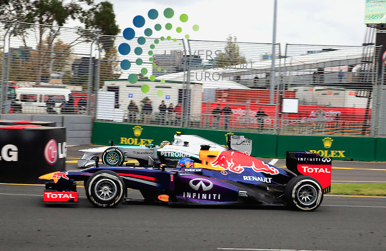 Formula 1 Rolex Australian Grand Prix, 15. - 17.03.2013 .Sebastian Vettel (D), Red Bull Racing, Lewis Hamilton (GB), Mercedes GP...Lotus's Kimi Raikkonen beat Ferrari's Fernando Alonso in a tense strategic battle in the season-opening Australian Grand Prix..Raikkonen made only two pit stops for fresh tyres compared to Alonso's three and the Finn carefully managed his race to hold off the Ferrari's challenge..Red Bull's Sebastian Vettel took third ahead of Ferrari's Felipe Massa and Lewis Hamilton's Mercedes. .Picture: Hasan Bratic/Universal News And Sport (Europe) 17 March 2013.