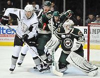 San Antonio Rampage left wing Garrett Wilson, left, looks for a deflection in front of Iowa Wild goaltender John Curry, right, and Iowa forward Mike Ullrich during the second period of an AHL hockey game, Saturday, Jan. 25, 2014, in San Antonio (Darren Abate/AHL)