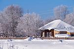 Traditional russian country house izba in village Talitsa under winter snow. Altai, Siberia, Russia