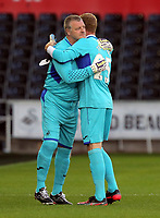 (L-R) Roger Freestone hugs Gerhard Tremmel during the Alan Tate Testimonial Match, Swansea City Legends v Manchester United Legends at the Liberty Stadium, Swansea, Wales, UK