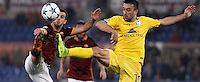 Calcio, Champions League: Gruppo E - Roma vs Bate Borisov. Roma, stadio Olimpico, 9 dicembre 2015.<br /> Roma's Miralem Pjanic, left, and Bate Borisov's Nemanja Nikolic fight for the ball during the Champions League Group E football match between Roma and Bate Borisov at Rome's Olympic stadium, 9 December 2015.<br /> UPDATE IMAGES PRESS/Isabella Bonotto