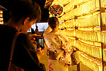 Visitors take pictures next to the lanterns during the annual ''Mitama Festival'' at Yasukuni Shrine on July, 13, 2017, Tokyo, Japan. Over 30,000 lanterns are displayed along the entrance of the shrine to help spirits find their way during the annual celebration for the spirits of ancestors. The festival runs until July 16th. (Photo by Rodrigo Reyes Marin/AFLO)