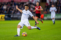 Neil Taylor of Swansea City crosses the ball during the Premier League match between Swansea City and Bournemouth at The Liberty Stadium, Swansea, Wales, UK. Saturday 31 December 2016