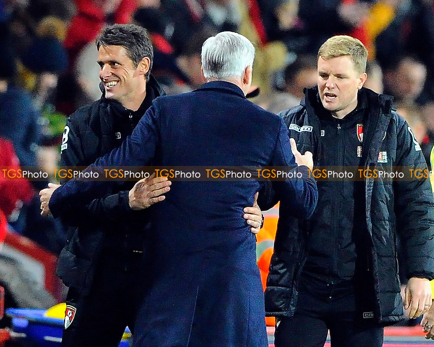 AFC Bournemouth Assistant Manager Jason Tindall left looks happy as Crystal Palace Manager Alan Pardew and AFC Bournemouth Manager Eddie Howe shake hands at full time during AFC Bournemouth vs Crystal Palace at the Vitality Stadium