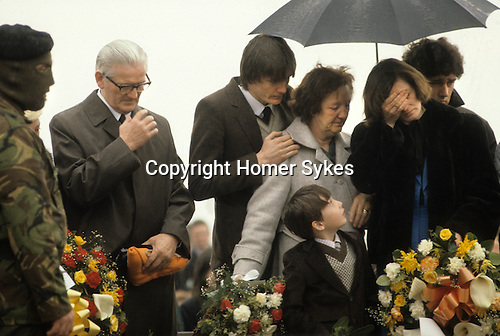Bobby Sands, ( Robert Gerard Sands) funeral his mother in pale coat, wife Geraldine Noade with hand to face. Son Gerard looking up 1981. Milltown cemetery Northern Ireland UK