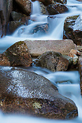 Flume Brook in the scenic Flume Gorge in Franconia Notch State Park, New Hampshire during the spring months.