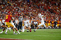 LOS ANGELES, CA - SEPTEMBER 7: Stanford Cardinal Jet Toner #26 kicks an extra point with a ball held by Alex Gracey #33 during a game between USC and Stanford Football at Los Angeles Memorial Coliseum on September 7, 2019 in Los Angeles, California.