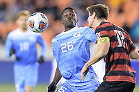 Houston, TX - Friday December 9, 2016: Drew Skundrich (12) of the Stanford Cardinal heads the ball in front of Jelani Pieters (26) of the North Carolina Tar Heels at the NCAA Men's Soccer Semifinals at BBVA Compass Stadium in Houston Texas.