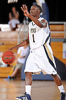 25 February 2012:  FIU guard Deric Hill (1) signals to teammates in the second half as the FIU Golden Panthers defeated the University of South Alabama Jaguars, 81-74, at the U.S. Century Bank Arena in Miami, Florida.