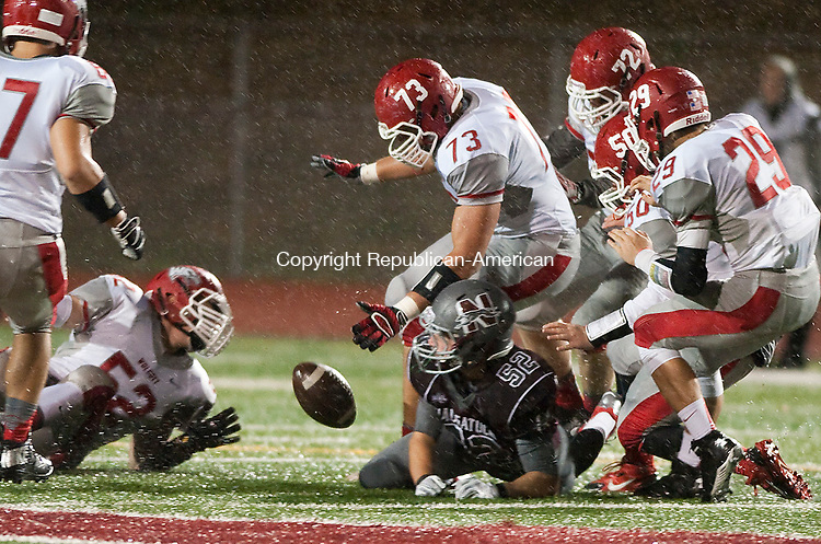 NAUGATUCK, CT--- -100215JS01---Wolcott's Cole Phelps (73) recovers an onside kick on the first play of the night during their game against Naugatuck Friday at Naugatuck High School. <br /> Jim Shannon Republican-American