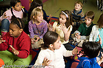 Education Elementary Grade 2 group of students sitting on rug responding to question horizontal