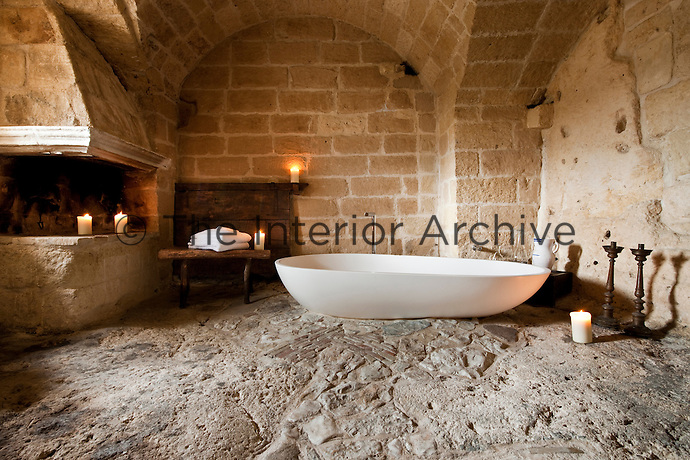 This free standing bath adds a touch of contemporary style to this bathroom at the unique Albergo Diffuso Le Grotte della Civita in Southern Italy, housed in  restored caves