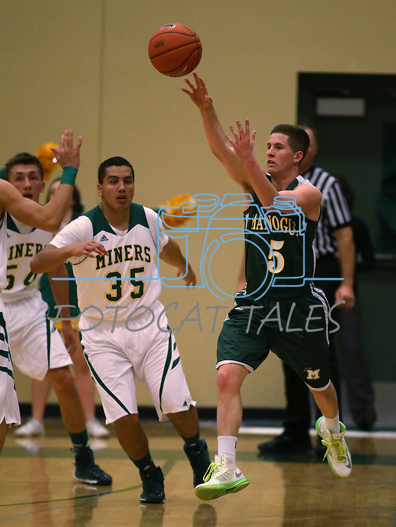 Alumni Gray Reid competes against Manogue defender Jack Mayer in the alumni game at the Wild West Shootout at Bishop Manogue High School in Reno, Nev., on Wednesday, Dec. 4, 2013. The Miners defeated the alumni 79-62. <br /> Photo by Cathleen Allison