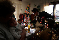 Bachelors visit neighbors during Carnival in the small village of Kosec outside Dreznica, Slovenia (population 65).  The men dress in costume and rap on every door in town. Neighbors invite them in to eat and drink in celebration. The people of old Europe thought that evil caused the dark and cold winter. When spring arrived, they came out to rejoice that light wins over darkness, and to begin another year.