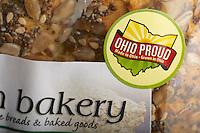 "Sticker on a package of commercial bread from a natural foods grocery store promoting buying local --""Ohio Proud, Made in Ohio, Grown in Ohio"", USA"