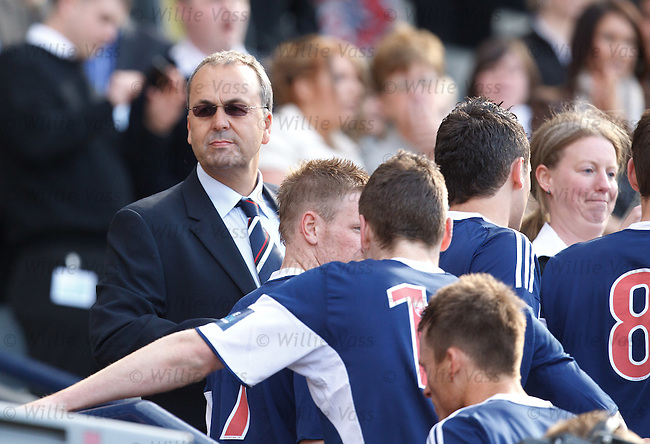 Ross County chairman Roy MacGregor as his players collect their runners up medals