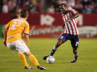 Chivas USA forward Atiba Harris puts the move on Houstons Bobby Boswell. The Houston Dynamo and Chivas USA played to a 1-1 tie at Home Depot Center stadium in Carson, California on Saturday October 25, 2008. Photo by Michael Janosz/isiphotos.com