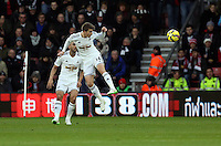 Pictured: Tom Carroll of Swansea heads the ball away Sunday 01 February 2015<br />