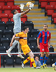 Steaua keeper Rufay Zapata saves from Jamie Murphy