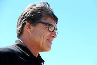 Sept. 21, 2013; Ennis, TX, USA: Texas governor Rick Perry in attendance during NHRA qualifying for the Fall Nationals at the Texas Motorplex. Mandatory Credit: Mark J. Rebilas-