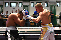 Jack Newham (white/gold shorts) draws with Naheem Chaudrhy during a Boxing Show at York Hall on 8th June 2019