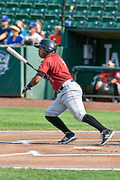 Meibrys Viloria (4) of the Idaho Falls Chukars  follows through on his swing against the Ogden Raptors during the Pacific Coast League game at Smith's Ballpark on August 29, 2016 in Salt Lake City, Utah. The Chukars defeated the Raptors 3-0. (Stephen Smith/Four Seam Images)