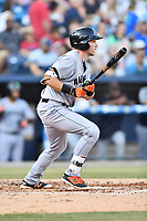 Augusta GreenJackets designated hitter Ryan Kirby (9) swings at a pitch during a game against the Asheville Tourists at McCormick Field on June 15, 2018 in Asheville, North Carolina. The Tourists defeated the GreenJackets 6-5. (Tony Farlow/Four Seam Images)