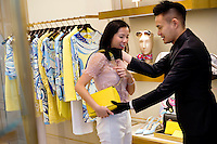 HONG KONG - MAY 04: Patricia Szeto shops for a handbag in a fashion store in IFC (International Finance Center) shopping mall in Central business district, on May 4, in Hong Kong. (Photo by Lucas Schifres/Pictobank)