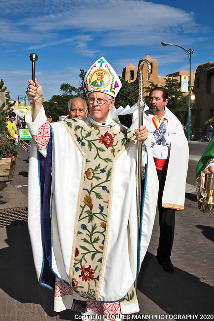 Archibishop Michael Sheehan blesses the 2009 Spanish Market at the Sunday moring Artist's Procession on the plaza in Santa Fe, New Mexico