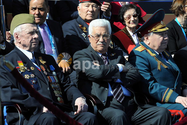 Palestinian President Mahmoud Abbas takes part in a ceremony in the Kremlin prior to the Victory Parade marking the 70th anniversary of the defeat of the Nazis in World War II, in Red Square, Moscow, Russia, Saturday, May 9, 2015. Photo by Thaer Ganaim