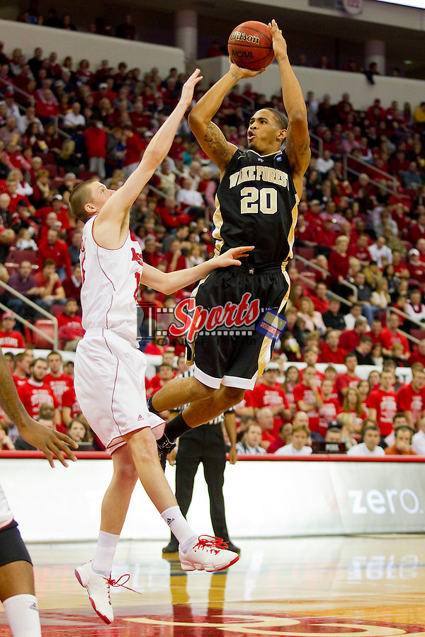Ari Stewart #20 of the Wake Forest Demon Deacons takes a jump shot over Scott Wood #15 of the North Carolina State Wolfpack at the RBC Center on January 8, 2011 in Raleigh, North Carolina.  The Wolfpack defeated the Demon Deacons 90-69.  Photo by Brian Westerholt / Sports On Film