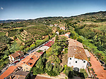 Tower view of of the village roofs and surrounding farms of Vinci, Tuscano, Italy