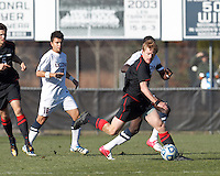 Northeastern University defender Jonathan Eckford (6) dribbles on offense..NCAA Tournament. University of Connecticut (white) defeated Northeastern University (black), 1-0, at Morrone Stadium at University of Connecticut on November 18, 2012.
