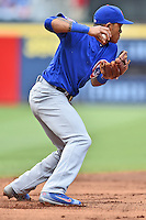 Chicago Cubs shortstop Addison Russell (27) fields the ball and throws to second to start the turn on a double play during a game against the Atlanta Braves at Turner Field on June 11, 2016 in Atlanta, Georgia. The Cubs defeated the Braves 8-2. (Tony Farlow/Four Seam Images)