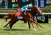 Uni (no. 1) wns the Fasig-Tipton De La Rose Stakes, Aug. 4, 2018 at the Saratoga Race Course, Saratoga Springs, NY.  Ridden by Irad Ortiz, Jr., and trained by Chad Brown, Uni finished a head in front of Precieuse (no. 5).  (Photo credit: Bruce Dudek/Eclipse Sportswire)