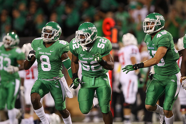 Denton, TX - NOVEMBER 10: Marcus Trice #8 and Jeremy Phillips #45 celebrate Derek Akunne #52 of the North Texas Mean Green tackle for a loss of yardage for the University of South Alabama Jaguars at Apogee Stadium in Denton on November 10, 2012 in Denton, Texas. Photo by: Rick Yeatts
