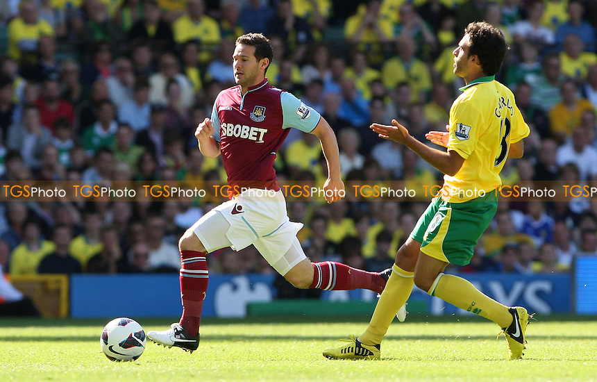 Matt Jarvis of West Ham and Javier Garrido of Norwich - Norwich City vs West Ham United, Barclays Premier League at Carrow Road, Norwich - 15/09/12 - MANDATORY CREDIT: Rob Newell/TGSPHOTO - Self billing applies where appropriate - 0845 094 6026 - contact@tgsphoto.co.uk - NO UNPAID USE.