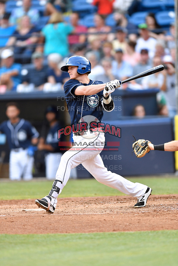 Asheville Tourists first baseman Taylor Snyder (28) swings at a pitch during a game against the Charleston RiverDogs at McCormick Field on July 6, 2017 in Asheville, North Carolina. The Tourists defeated the RiverDogs 13-9. (Tony Farlow/Four Seam Images)