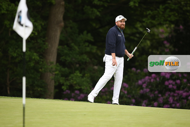 Shane Lowry (IRL) puts a tricky putt close on the 16th which ends in a bit of friendly banter with Branden Grace (RSA) during Round Three of the 2015 BMW PGA Championship over the West Course at Wentworth, Virginia Water, London. 23/05/2015. Picture David Lloyd   www.golffile.ie.