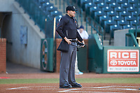 Home plate umpire Ben Fernandez prior to the South Atlantic League game between the Augusta GreenJackets and the Greensboro Grasshoppers at First National Bank Field on April 10, 2018 in Greensboro, North Carolina.  The GreenJackets defeated the Grasshoppers 5-0.  (Brian Westerholt/Four Seam Images)