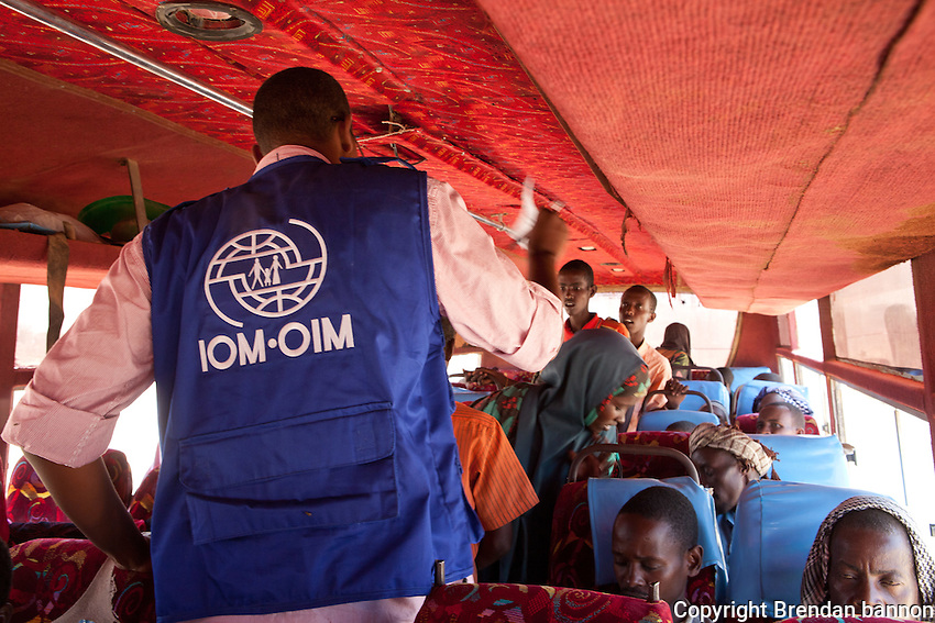 Somali refugees are bused by IOM from Liboi, Kenya to the refugee camps in Dadaab, Kenya. As of October 3, 2001 some 14,183 migrants were transported from Liboi to the Dadaab Campby IOM.