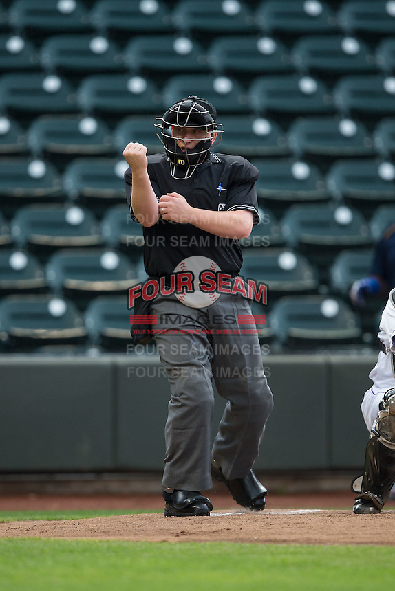 Home plate umpire Matt Bates makes a strike call during the Carolina League game between the Myrtle Beach Pelicans and the Winston-Salem Dash at BB&T Ballpark on May 2, 2016 in Winston-Salem, North Carolina.  The Pelicans defeated the Dash 3-2 in 11 innings.  (Brian Westerholt/Four Seam Images)