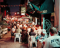 Sidewalk Cafe in Little Italy at night New York City July, 1997. Restaurants, Tourism, Night Life. New York City NY USA China Town, Manhattan.