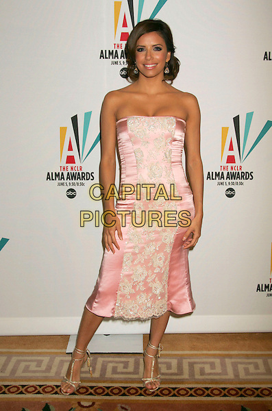 EVA LONGORIA.Press conference for the 2006 American Latino Media Arts Awards held at the Peninsula Hotel, Beverly Hills, California, USA, 04 April 2006..full length pink strapless satin lace dress gold strappy sandals shoes tassles .Ref: ADM/RE.www.capitalpictures.com.sales@capitalpictures.com.©Russ Elliot/AdMedia/Capital Pictures.