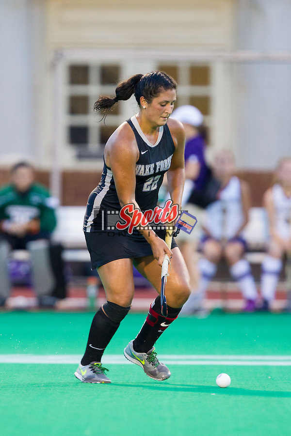 Anna Kozniuk (22) of the Wake Forest Demon Deacons pushes the ball up the field during second half action against the Northwestern Wildcats at Kentner Stadium on September 11, 2014 in Winston-Salem, North Carolina.  The Demon Deacons defeated the Wildcats 1-0.  (Brian Westerholt / Sports On Film)