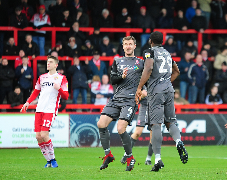 Lincoln City's John Akinde celebrates scoring the opening goal with team-mate Michael O'Connor<br /> <br /> Photographer Andrew Vaughan/CameraSport<br /> <br /> The EFL Sky Bet League Two - Stevenage v Lincoln City - Saturday 8th December 2018 - The Lamex Stadium - Stevenage<br /> <br /> World Copyright © 2018 CameraSport. All rights reserved. 43 Linden Ave. Countesthorpe. Leicester. England. LE8 5PG - Tel: +44 (0) 116 277 4147 - admin@camerasport.com - www.camerasport.com