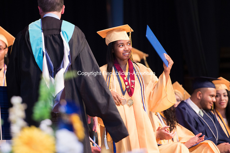 WATERBURY, CT-19 June 2015-061915EC10-  Student Ashanti Fleming gets her diploma on stage at Kennedy's High School graduation Friday night. Erin Covey Republican-American