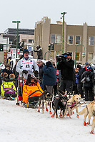 Alan Eischens and team leave the ceremonial start line with an Iditarider and handler at 4th Avenue and D street in downtown Anchorage, Alaska on Saturday March 7th during the 2020 Iditarod race. Photo copyright by Cathy Hart Photography.com